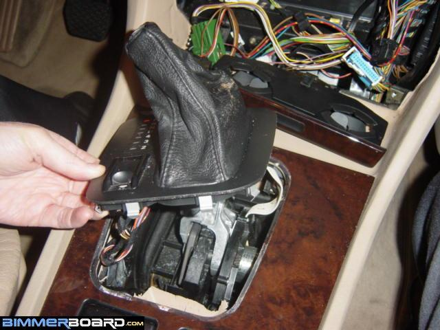 Photos and directions for disassembly of the center console first remove the gearshift knob and leather boot to remove the knob put the car in neutral depress the button and pull up it helps to have someone help sciox Choice Image