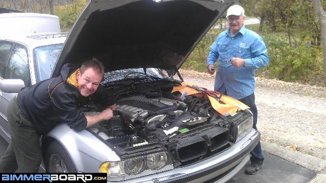 Photos of changing spark plugs on an '01 750iL V12 engine at