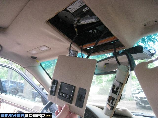 Remove The Cover Panel For Garage Door Opener And Sunroof Button